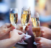 People holding glasses of champagne making a toast Stock Photos