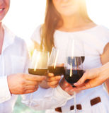 People holding glasses of red wine making a toast Stock Images