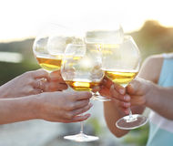 People holding glasses of red wine making a toast Stock Photo