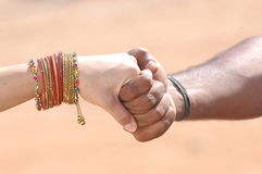 People holding hands. A couple holding hands in an embrace Stock Images