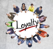 People Holding Hands Around Letter Loyalty Stock Image