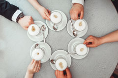 People holding in hands cups with coffe. Royalty Free Stock Photography