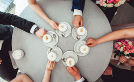 People holding in hands cups with coffe. Royalty Free Stock Image