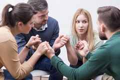 People holding hands on special group therapy Stock Images