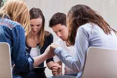 People holding hands on therapy Royalty Free Stock Photos