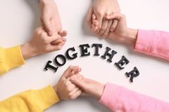 People holding hands and word TOGETHER Stock Photography
