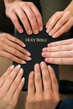 People holding holy bible Royalty Free Stock Images