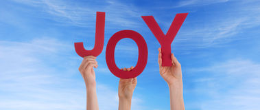 People Holding Joy in the Sky Royalty Free Stock Photography