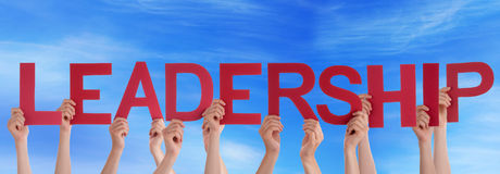 People Holding Leadership in the Sky. Many Hands Holding the Red Word Leadership in the Sky Royalty Free Stock Photos