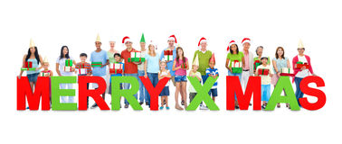 People Holding the Letter MERRY X'MAS Royalty Free Stock Image