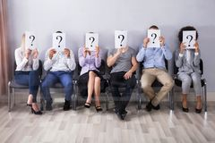 People Holding Question Mark Sign stock image