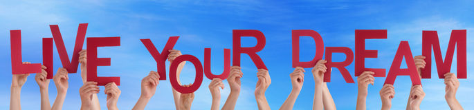 Free People Holding Red Word Live Your Dream Blue Sky Royalty Free Stock Photo - 53953845