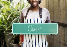 People holding shop open sign Stock Photos