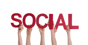 People Holding Social. Many People Holding the Red Word Social, Isolated Stock Photo