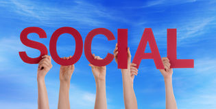 People Holding Social in the Sky. Many People Holding the Red Word Social in the Sky Royalty Free Stock Photo