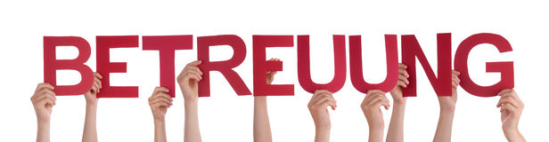 People Holding Straight Word Betreuung Means Care Stock Photo