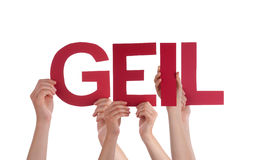 People Holding Straight  Word Geil Means Cool Stock Image