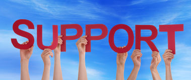 People Holding Support in the Sky Royalty Free Stock Images