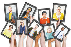 People Holding Tablets with People Profiles Stock Photo