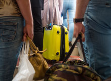 People are holding their hand baggage before boarding an aircraft Stock Images