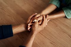 People holding their hands tight together royalty free stock photos