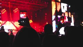 People holding their smart phones and photographing shooting concert moments technology 4k stock video