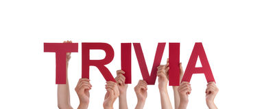 People Holding Trivia. Many People Holding the Red Word Trivia, Isolated Royalty Free Stock Photos