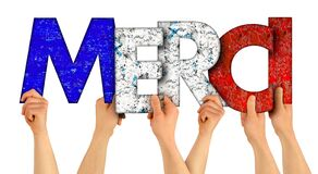 People holding up colorful red blue france flag wooden letter with french word merci  english translation: thank you  isolated