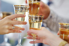 People holding wine glasses at festive event. Some people holding wine glasses at festive event stock images