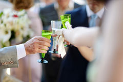 People holding wine glasses at festive event Royalty Free Stock Photos