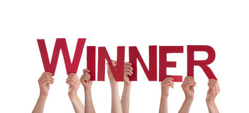People Holding Winner Stock Images