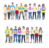 People Holding Word Friendship and Community.  Royalty Free Stock Photography