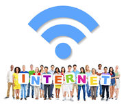 People Holding Word Internet with Internet Symbol Stock Photos