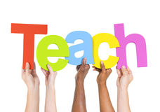 People Holding The Word Teach. Multi-Ethnic Group Of People Holding The Word Teach stock images