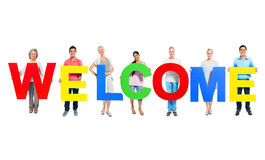 People Holding The Word Welcome Royalty Free Stock Photos