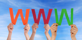 People Holding WWW in the Sky Stock Images