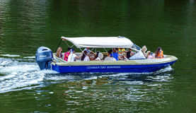 People in holiday cruising in a speedboat on Danube river. Romania, Orsova town by the Danube river - July 30, 2016 - people in holiday are cruising at speed in Stock Photography