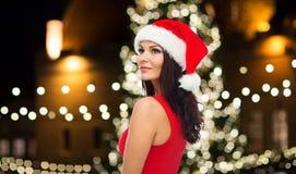 Beautiful sexy woman in santa hat at christmas Stock Photography