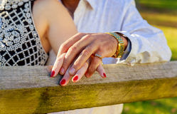People, holidays, engagement and love concept with diamond ring. People, holidays, engagement and love concept - close up of engaged couple holding hands with royalty free stock photo