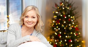 Happy middle aged woman at home on christmas royalty free stock photography