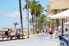 People holidays maker walking in seafront promenade of Torrevieja, Spain royalty free stock photography
