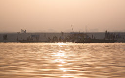 People in the holy river. Sunset at the Holy river of Ganga in Varanasi, Uttar Pradesh, India Stock Photo
