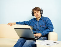 People at home listening to symphonic music Royalty Free Stock Images