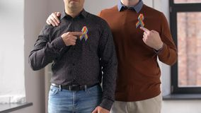 Male couple with gay pride awareness ribbons stock footage