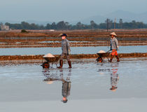 People on the Hon Khoi salt factory in Nha Trang, Vietnam Stock Photography