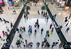 People in Hong Kong International airport. Hong Kong - 27 February, 2014: People waiting passengers from the incoming flight at Hong Kong International airport stock image