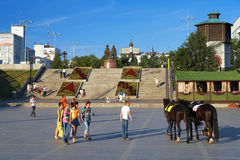 People and horses in the center of Ekaterinburg. People and horses in the historical square of Ekaterinburg, Russia Stock Images