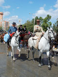 People on horses at the Seville Fair. stock images