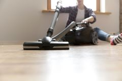 People, housework and housekeeping concept - happy woman with vacuum cleaner at home. Spring cleaning.  Stock Photos