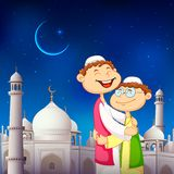 People hugging and wishing Eid Mubarak Royalty Free Stock Photo
